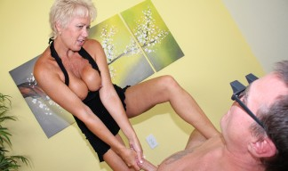tracy tugging a younger man's cock